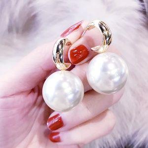 bug oversized pearl earrings